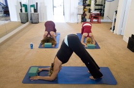 yoga 3 women doing the downward dog